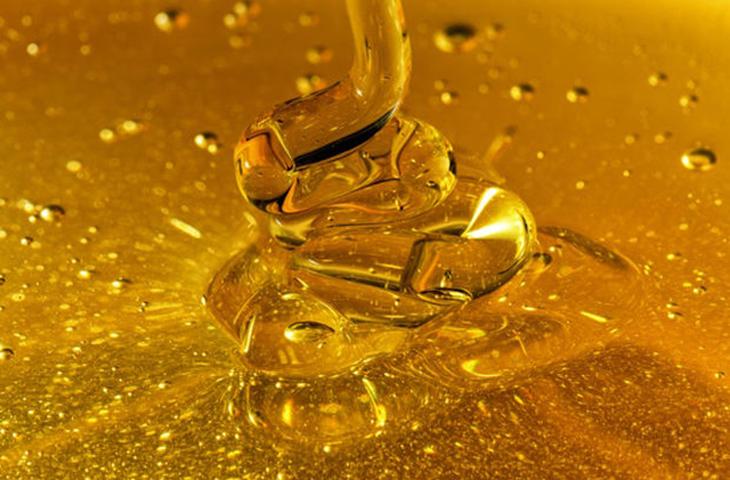 Closeup Honey Pouring Waves
